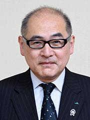 比嘉政浩(ひが・まさひろ)専務理事.jpg