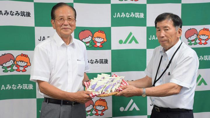 社会福祉協議会の山田会長(左)と吉田組合長