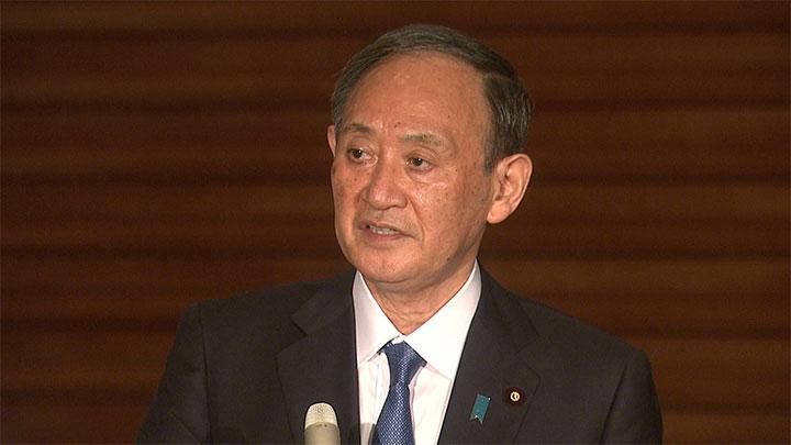 会見する菅首相