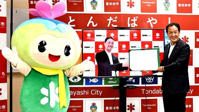 包括連携協定を結んだ吉村市長(写真右)と村中氏